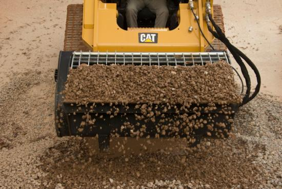 Cat® Mixing Bucket Scooping Rock