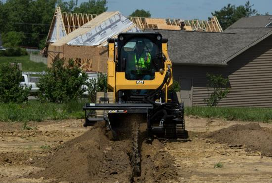 Cat® 259D Compact Track Loader and T9B Trencher Attachment Digging a Trench
