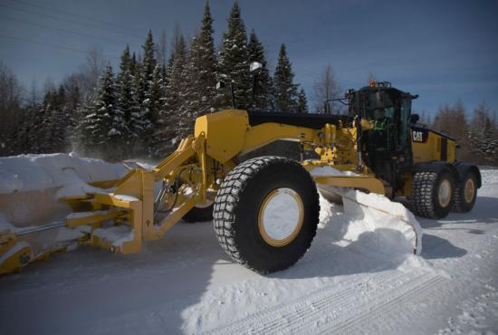 14 grader plowing snow with front blade