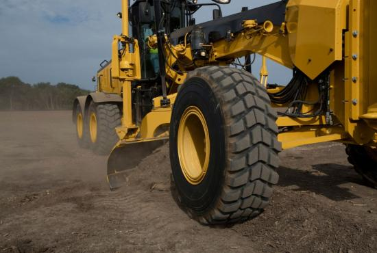 Leveling the ground with the 14 road grader
