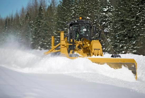14 motor grader plowing  with snow wing